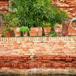 Old red brick wall along a canal in Venice — Stock Photo