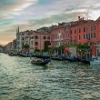 Gondolas floating on the Grand Canal at sunset in Venice — Stock Photo #26593785