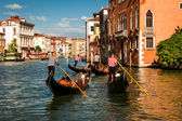 Gondoliers floating on a Grand Canal, Venice, Italy — Stock Photo