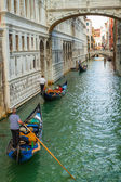 Gondoliers floating on a Grand Canal in Venice — Stock Photo