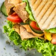 Closeup of kebab on bun with vegetables and meat — Stock Photo #27277567