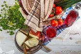 Picnic basket full of healthy and fresh produce — Stock Photo