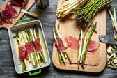 Preparation baked asparagus with prosciutto ham — Stock Photo