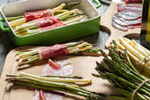 Preparation asparagus with prosciutto ham — Stock Photo
