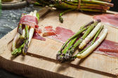 Preparation asparagus with prosciutto ham and cheese — Stock Photo