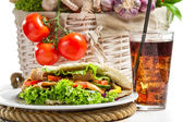 Kebab made of vegetables and meat served with cold cola — Stock Photo