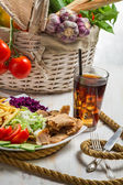 Vegetables and meat kebab served with fries and a Coke — Stock Photo