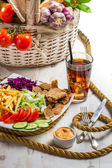 Vegetables, fries and meat kebab served with cold Coke — Stock Photo