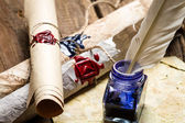 Closeup of ancient scrolls writing by feather with blue ink — Stock Photo