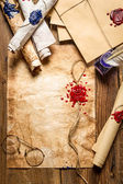 Closeup of old scrolls and sealing wax on wooden table — Stock Photo