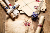 Old scrolls, sealing wax and blu ink on wooden table — Stock Photo