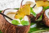 Closeup of pinacolada in a coconut — Stock Photo