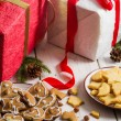 Snacking homemade christmas cookies on a plate on gifts backgrou — Stock Photo