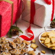 Stock Photo: Snacking homemade christmas cookies on plate on gifts backgrou
