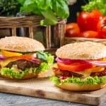 Closeup of two homemade hamburgers — Stock Photo