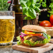 Stock Photo: Homemade burger and cold beer