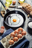 Fresh eggs for breakfast fried on a pan — Stock Photo