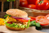 Closeup of hamburger with chicken, tomato and vegetables — Stock Photo