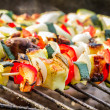Foto de Stock  : Hot skewers on grate
