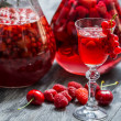 Stock Photo: Liqueur made of wild berries and alcohol