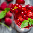 Stock Photo: Closeup of liqueur made of wild berries and mint