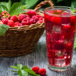 Stock Photo: Juice of fresh raspberries served with ice in glass