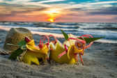 Tropical cocktail on the beach at sunset — Stock Photo