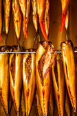Fresh smoked fish in smokehouse — Zdjęcie stockowe