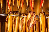 Closeup of smoked fish in smokehouse — Zdjęcie stockowe