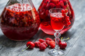 Liqueur made of wild berries and alcohol — Stock Photo