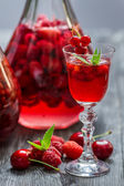 Liqueur made of wild berries and mint — Stock Photo