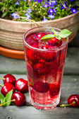 Fresh juice of sweet cherries with ice — Stock Photo