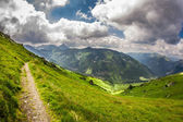 Panoramic view of mountain peaks from the trail in summer — Stock Photo