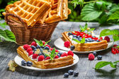 Waffels with cream and blueberry and raspberry — Stock Photo