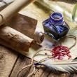 Old scrolls and candles are the old scribe's workplace — Stock Photo