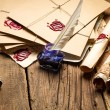 Old scrolls and candles are the old scribe's workplace — Stockfoto