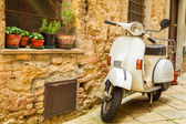 Vintage scene with Vespa on old street — Stock Photo