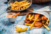 Fish & Chips served in the newspaper — Stock Photo