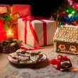 Closeup of a table set with Christmas gifts — Stockfoto