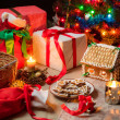 Stock Photo: View of the Christmas table with presents and a Christmas tree