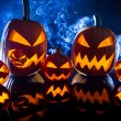 Group strange halloween pumpkins on black background with smoke — Stock Photo