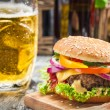 Fresh homemade burger and a cold beer — Stock Photo #30359331