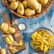 Homemade French fries made from potatoes — Stock Photo #30359539