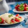 Strawberry pancakes sprinkled with icing sugar — Stock Photo