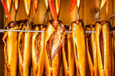 Closeup of fresh smoked fish in smokehouse — Zdjęcie stockowe