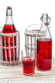 Red juice in bottles on white background — Stock Photo