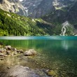 Beautiful lake with clear water in the mountains — Stock Photo