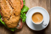 Coffee and sandwich for breakfast — Stock Photo