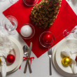 Richly laid table ready for Christmas Eve — Stock Photo