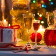 Stock Photo: Christmas drinks and presents for long winter nights